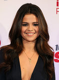 Selena Gomez wore her hair down and parted in the middle for an appearance at the 106.1 KISS FM' Jingle Ball in Dallas. She added loose curls and complemented the look with a neutral makeup palette.