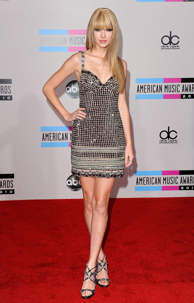 Taylor Swift edged up her usually femme red carpet looks with an edgy studded mini and coordinating sandals at the 2010 American Music Awards.