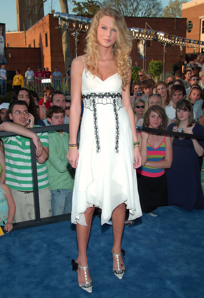 Taylor's flowing white dress and silver t-strap pumps are what fairy tales are made of.