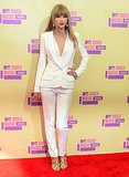 An ivory J. Mendel pantsuit, gold metallic Tom Ford sandals, and sleek strands set the sleek tone for the 2012 MTV VMAs.
