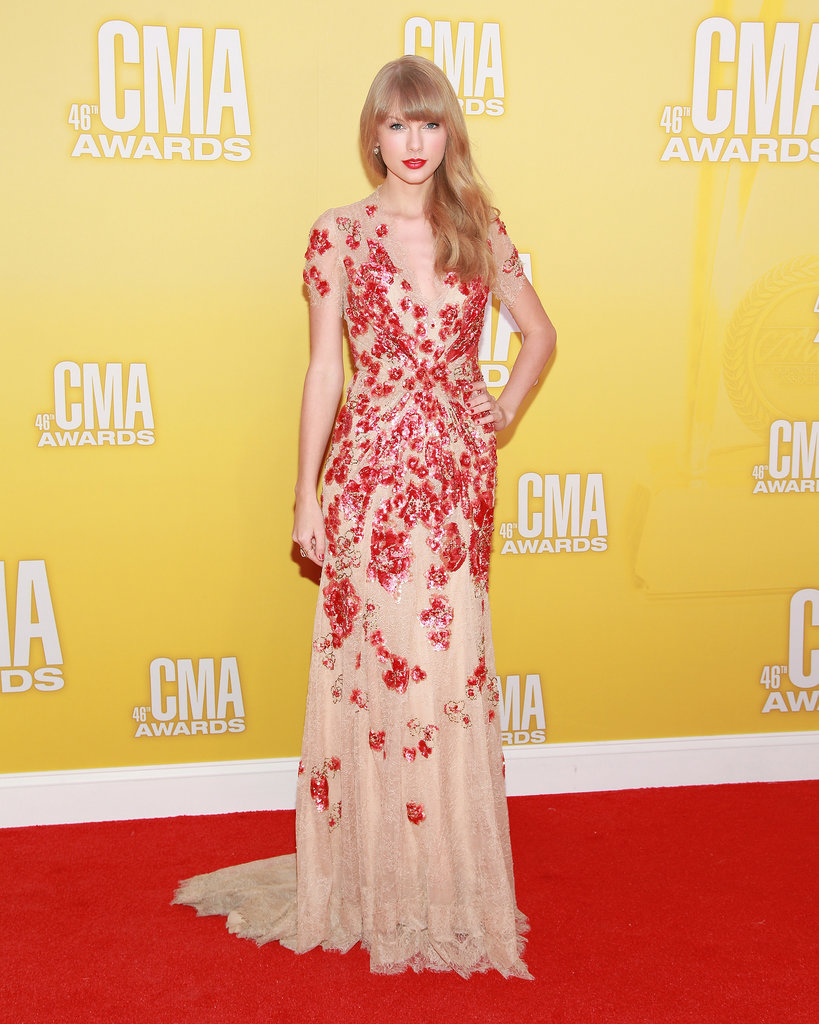 Taylor Swift put the glam in glamour working a red and nude embellished Jenny Packham gown and signature red lip for the CMA Awards in 2012.