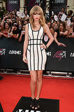 For the 2013 MuchMusic Video Awards, Taylor swapped her dramatic couture gowns for a funky fresh body-conscious Hervé Léger minidress and strappy cage booties.