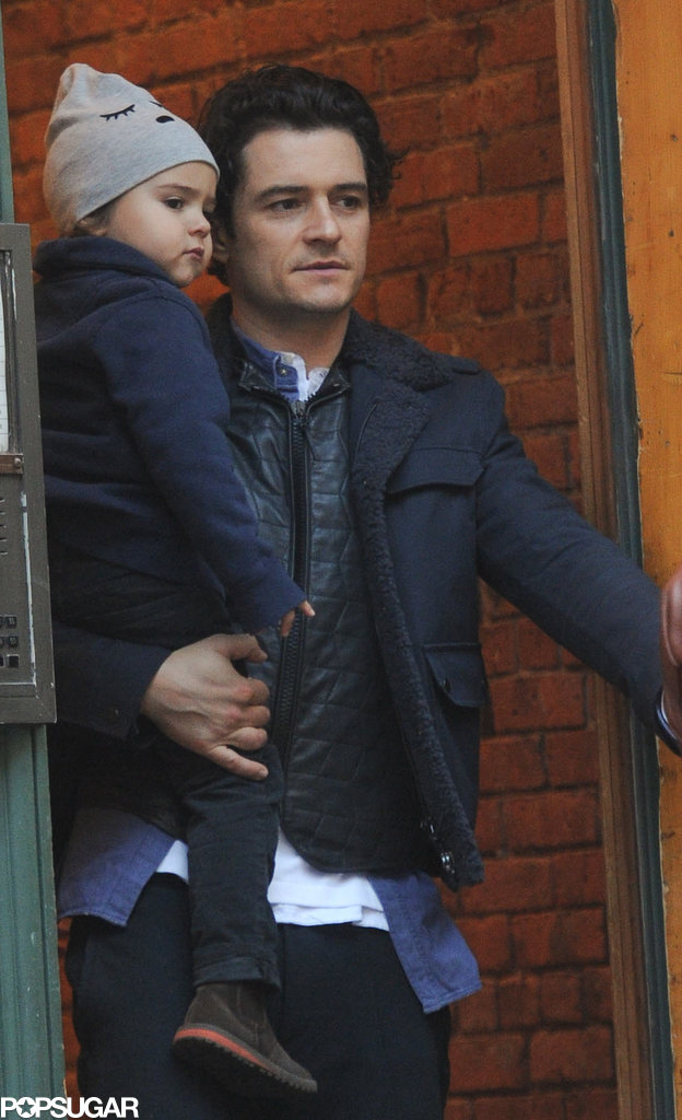Orlando Bloom bundled up baby Flynn for his afternoon in NYC.