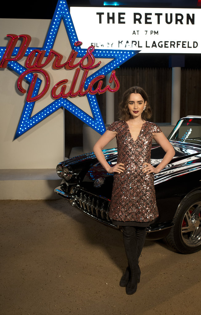 Lily Collins posed against a backdrop.
