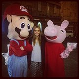 Cara Delevingne snuggled up to Mario and Peppa Pig. Source: Instagram user caradelevingne