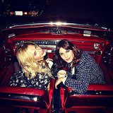 Alexa Chung and Poppy Delevingne took a timeout to pose in their red-hot ride. Source: Instagram user derekblasberg