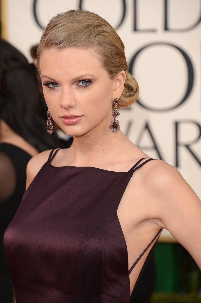 At the 2013 Golden Globe Awards, Taylor opted for a modern take on a vintage updo. Her golden hair was pulled back and twisted into a low roll.