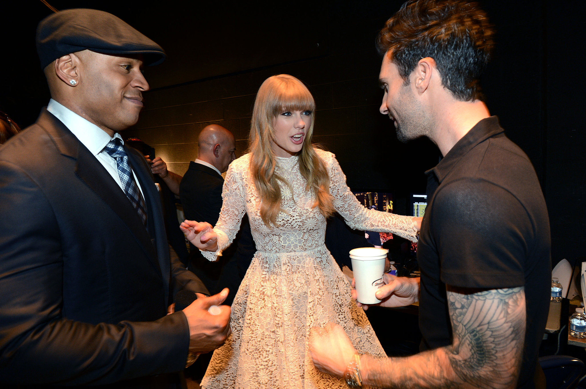 Taylor Swift hung backstage with LL Cool J and Adam Levine at the Grammy Nominations Concert in December 2012.