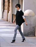 The actress braved the NYC Autumn in an oversize black sweater, crisp white blouse, gray skinny jeans, and leather booties.