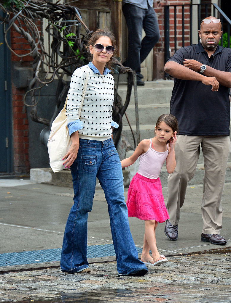 Holmes layered a polka-dot sweater over a chambray shirt and flared denim in NYC in July 2012. Suede Isabel Marant ankle boots, oversize round shades, and a graphic canvas tote completed her downtown-cool look perfectly.