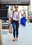 In June 2012, Katie Holmes strolled the streets of NYC wearing Isabel Marant's embroidered top with skinny jeans, pink sunglasses, tan flats, and a matching bag.