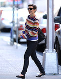 Katie's colorful sweater added a playful touch to her monochrome separates in October 2008.