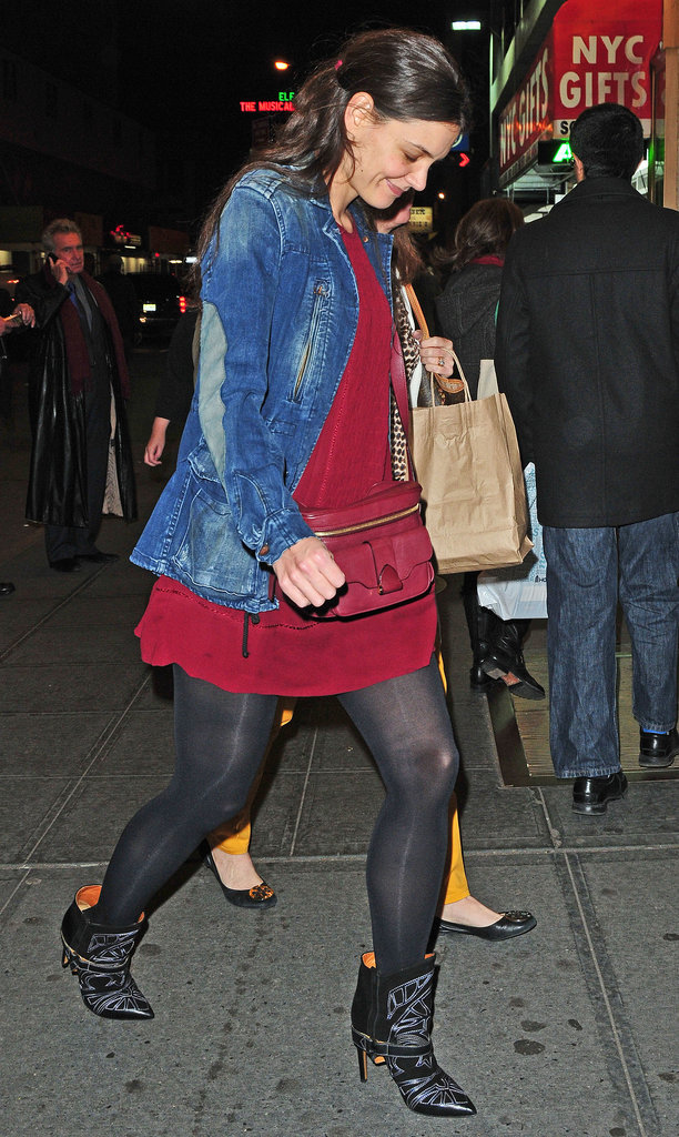 Dressing down her designer accessories — Isabel Marant cowboy boots and a Derek Lam camera bag — with an oxblood slip dress and elbow-patch jean jacket November 2012.