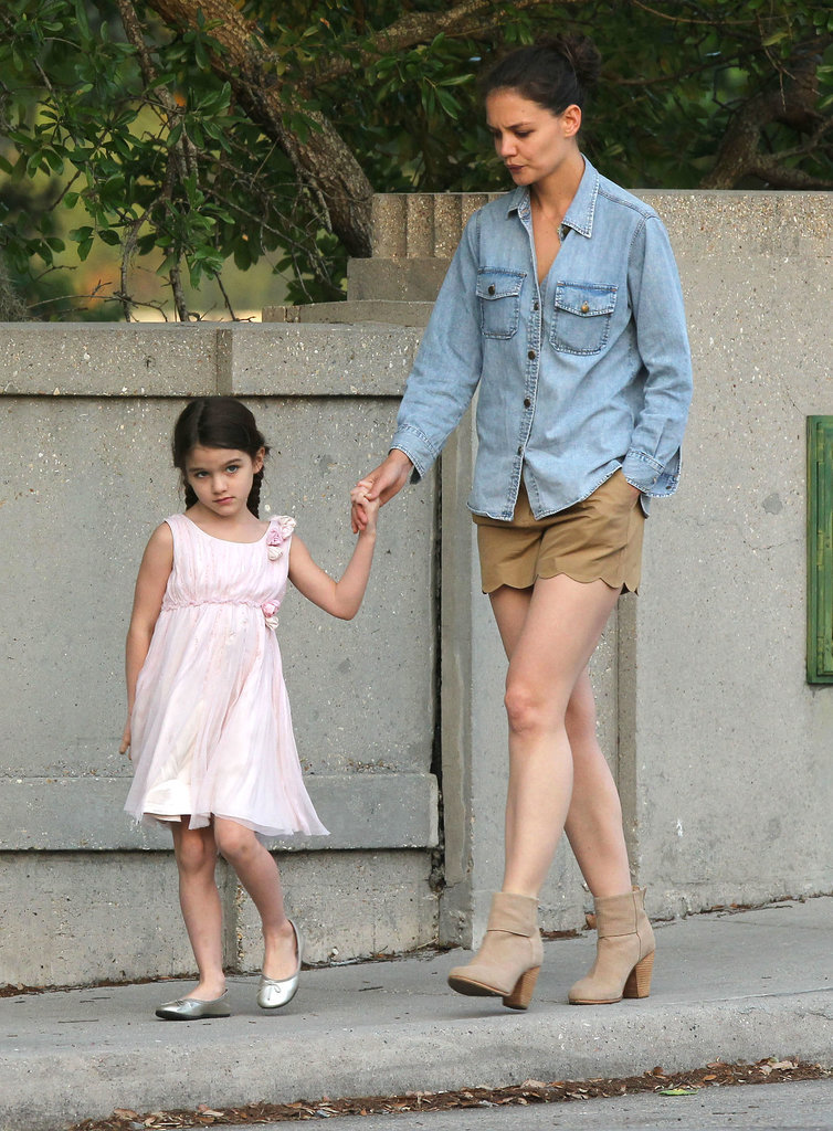 Katie paired her chambray Current/Elliott top with scalloped tan shorts and matching Rag & Bone booties in New Orleans.