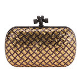 If you're looking for a statement-making investment piece, this Bottega Veneta knot clutch ($1,647) is as good as gold.