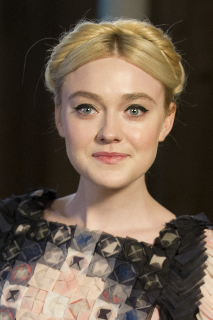 A twisted take on a milkmaid braid, like Dakota Fanning wore to Chanel's Metier d'Art show, keeps your hair out of your face while still looking incredibly chic.