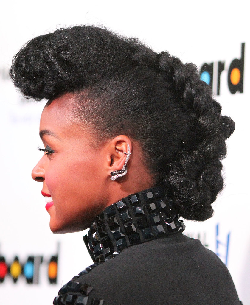 Janelle Monae shows that even ladies with natural hair can get creative with their holiday updos. Her pompadour slowly meanders into a twisted braid, creating a gorgeous, unexpected style.