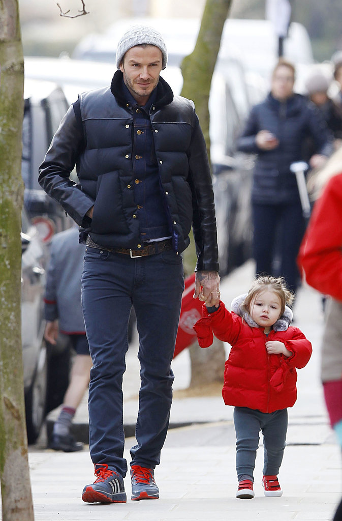 David held Harper's hand as the two went for a bundled-up stroll through London back in March.