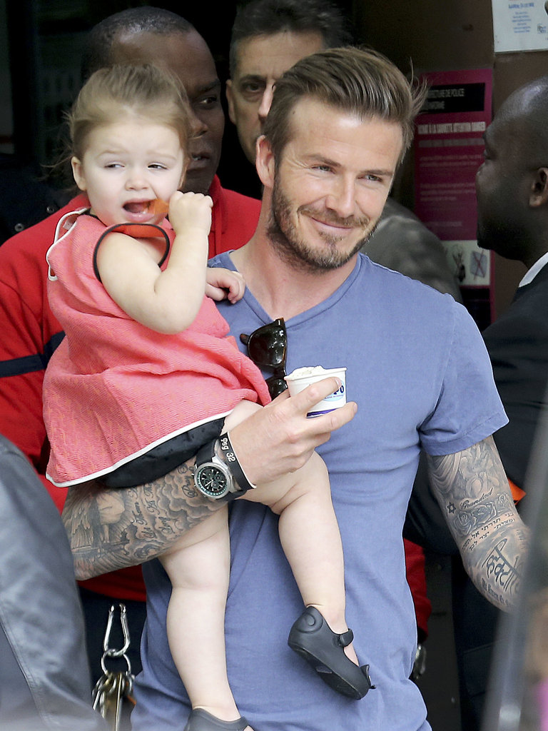 David was all smiles while carrying his daughter after they had a family lunch at the Eiffel Tower in May.<br />