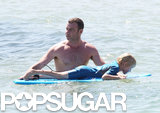 Liev Schreiber guided Sasha on his boogie board.