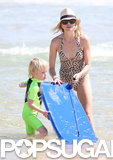 Naomi Watts helped Kai with his boogie board.