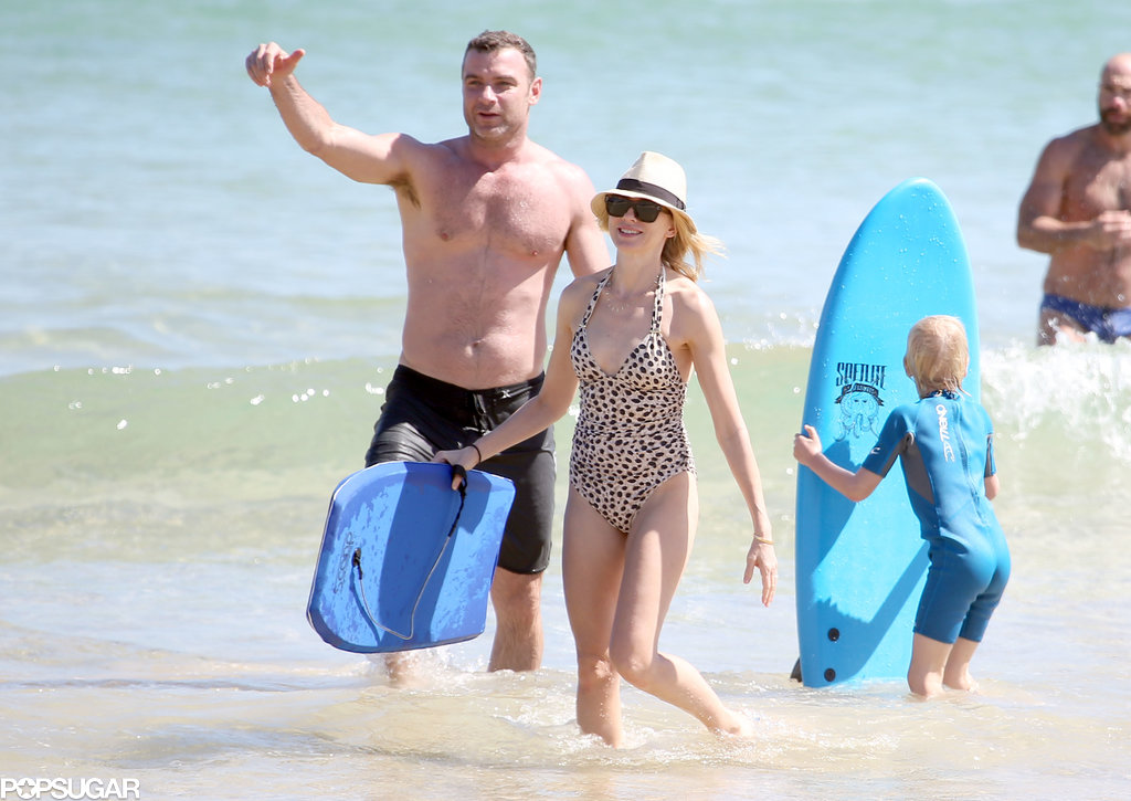 Liev Schreiber and Naomi Watts hit the beach with their family.