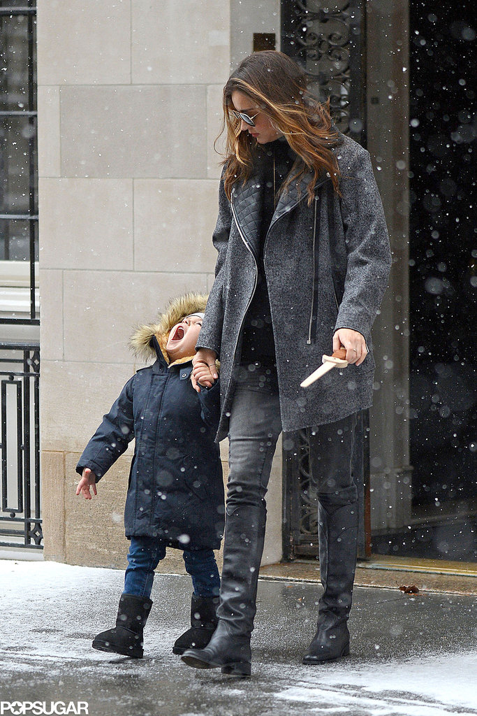 Flynn Bloom tried to catch snow in his mouth during a December outing in NYC with his mom, Miranda Kerr.