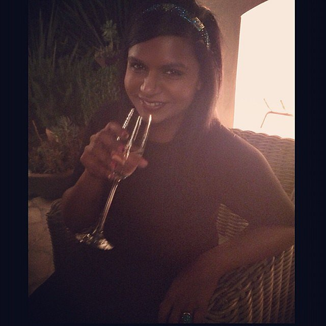 Mindy Kaling sipped champagne. Source: Instagram user mindykaling