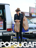 Gwen carried bags of toys to her car.