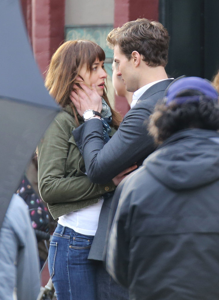 Dakota Johnson and Jamie Dornan got up close and physical on the Fifty Shades of Grey set in Vancouver on Thursday.