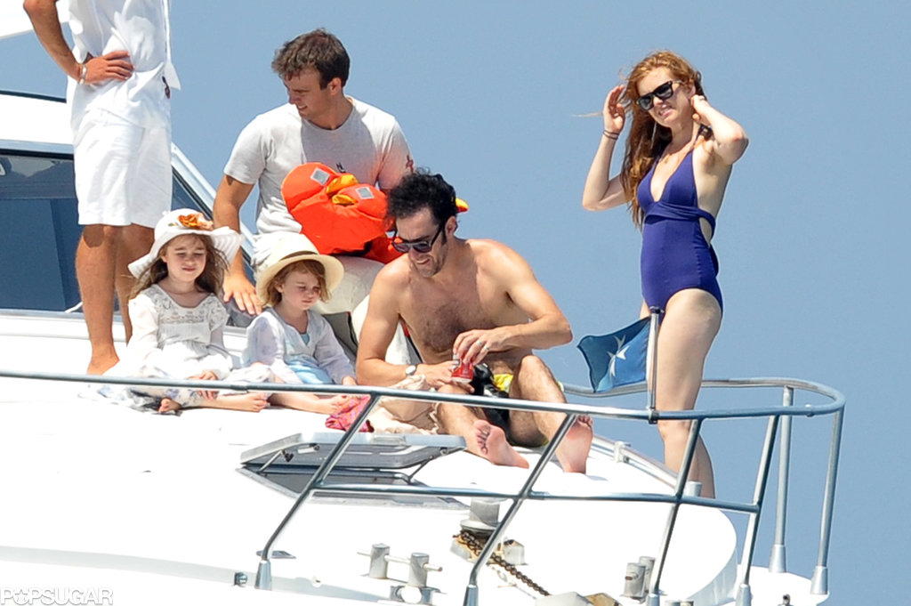 Sacha Baron Cohen and Isla Fisher took their daughters, Olive and Elula, on a yacht vacation in Capri, Italy, in July.