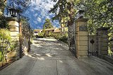 A gated entrance and long driveway offer plenty of privacy. Source: Teles Properties
