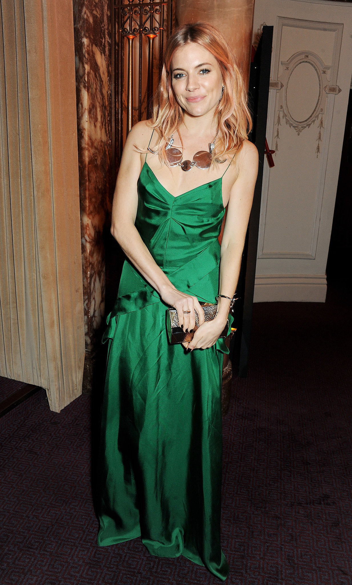 For the 2013 British Fashion Awards, Sienna had us green with envy choosing a silky Burberry gown and statement plated necklace.