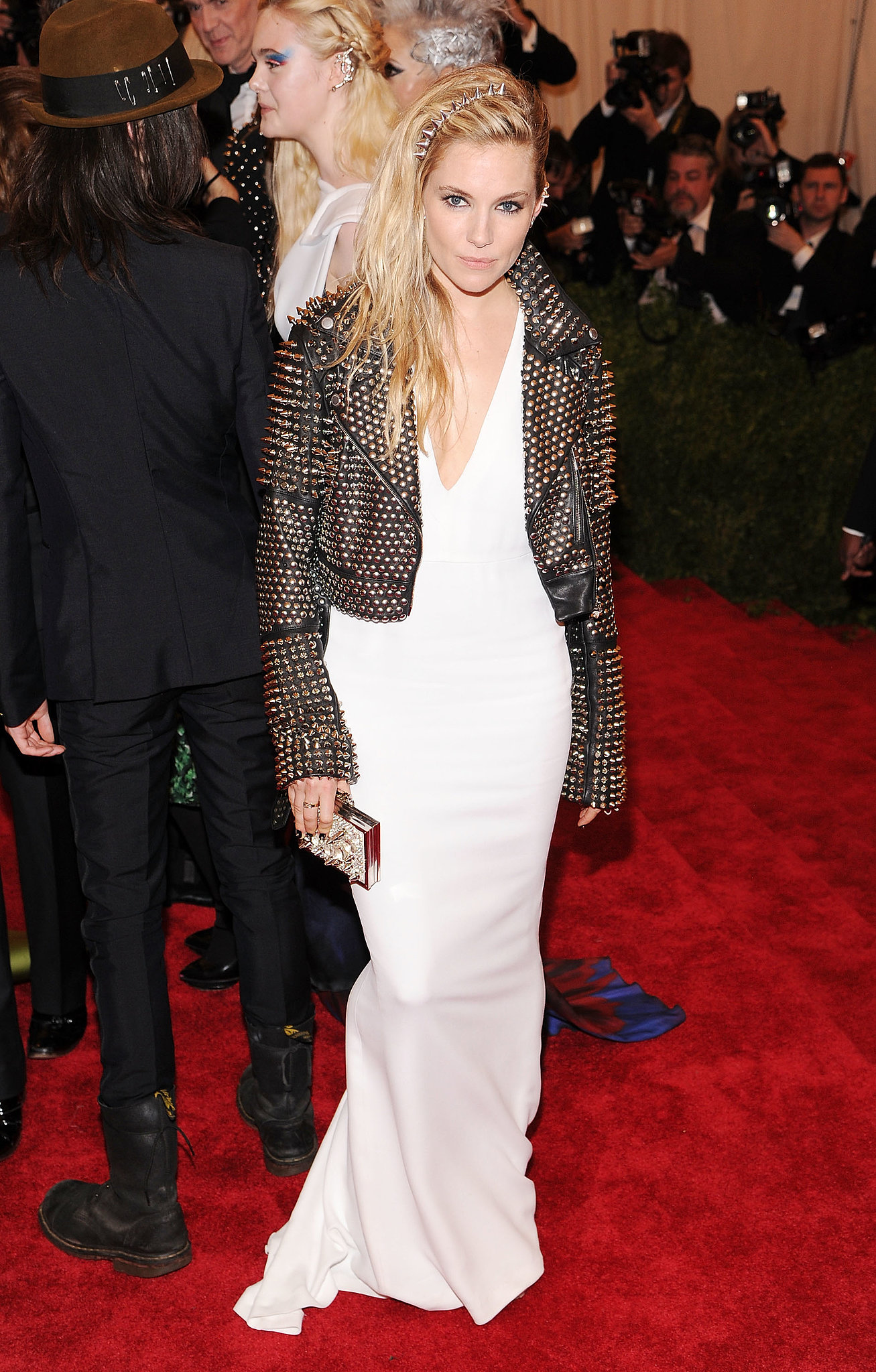 Let's all take a moment to appreciate the punk-princess realness Sienna gave us at the 2013 Met Gala. [silence] The actress decided to contrast her fluid crepe white gown with a black studded leather biker jacket, both by Burberry, and a matching spiked headband.