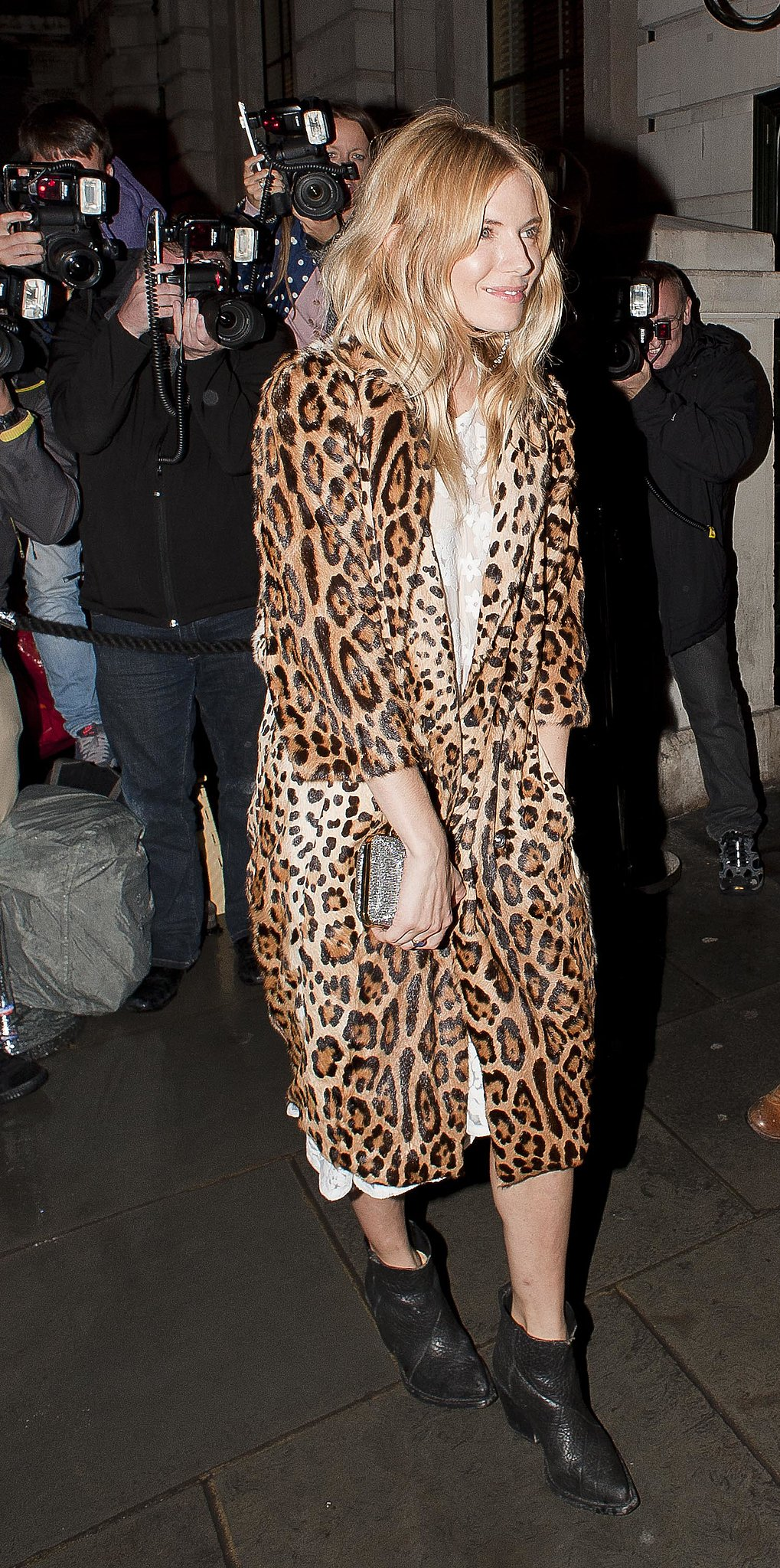 Sienna showcased her love of leopard in a plush printed coat for a Spring '14 London Fashion Week event.