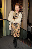 Sienna topped her animal-print Burberry sheath with a shaggy cardigan and Mary Janes for Kelly Hoppen's November 2013 book launch.