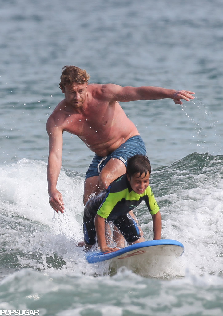 Simon Baker helped his son surf.