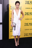 Presenting a more subdued take on the same palette, Jamie Chung sparkled plenty in a tasseled clutch and ruched white cocktail dress at The Wolf of Wall Street's New York premiere.