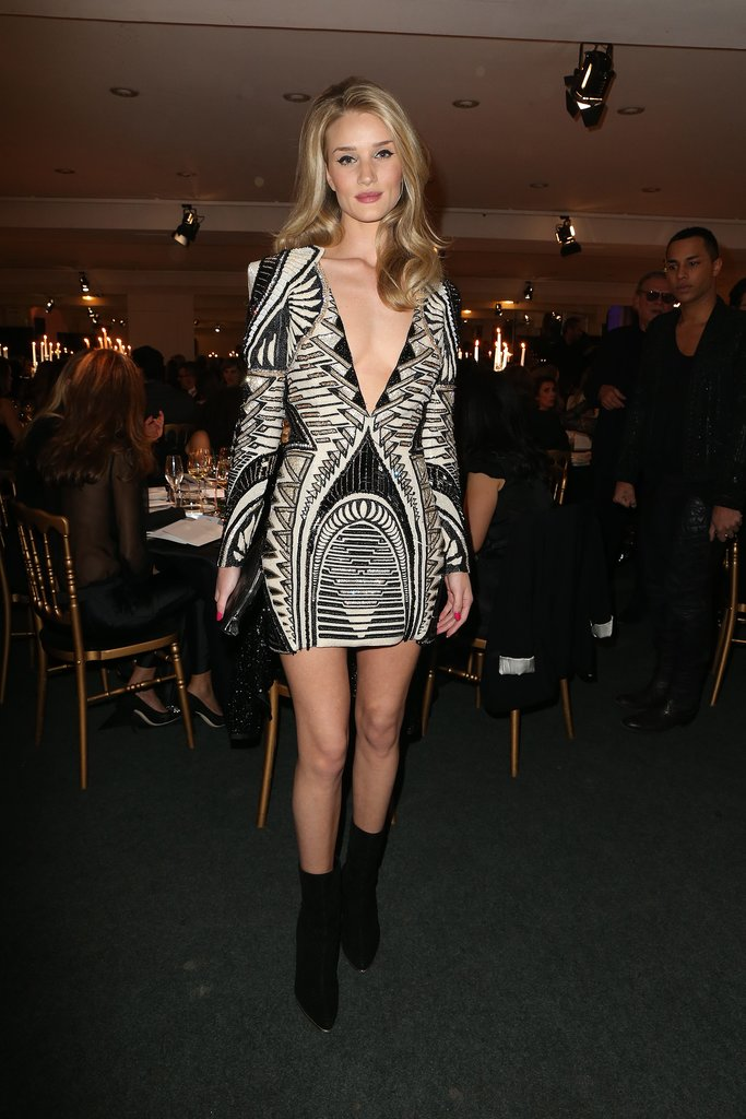 Rosie Huntington-Whiteley's Balmain mini may have been a bit risqué for the family Christmas table, but with a striking pattern and a bit of sparkle, it was just right for dinner with friends at the AEM Association Children of the World For Rwanda charity event in Paris.