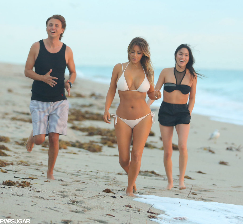Kim and her friends walked in the sand.