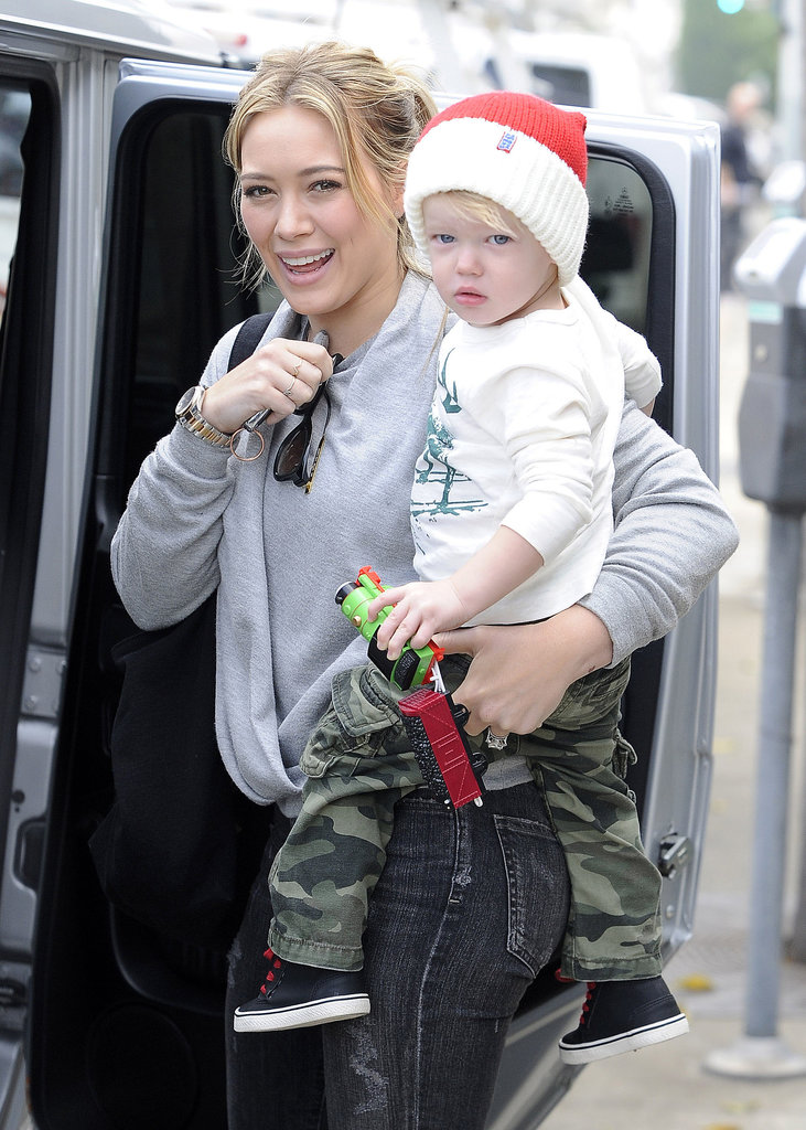 Hilary Duff held her son, Luca Comrie, while they ran errands in LA on Saturday.