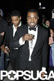 Kanye West and Kid Cudi sipped Champagne at the Met Gala afterparty in May 2011.