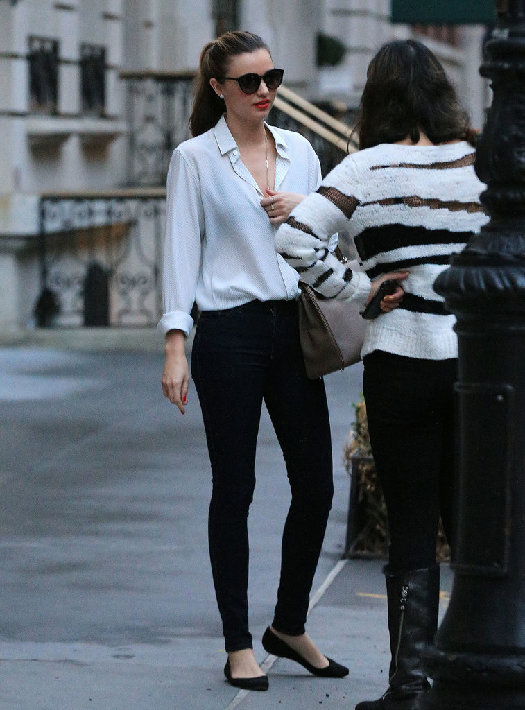 Miranda Kerr knows the power of a simple white tee and black skinnies.