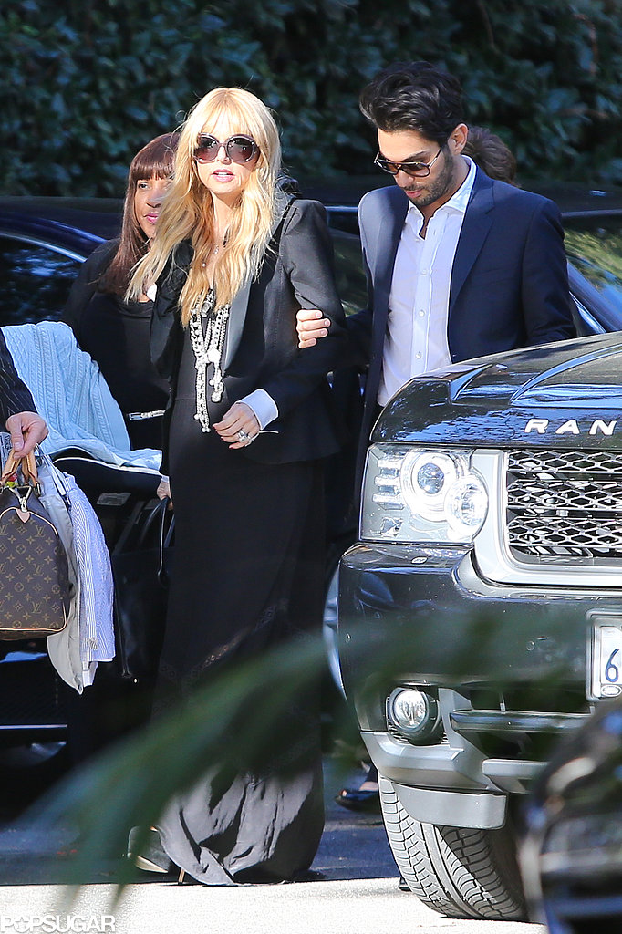 Rachel Zoe walked closely with her friends and family.