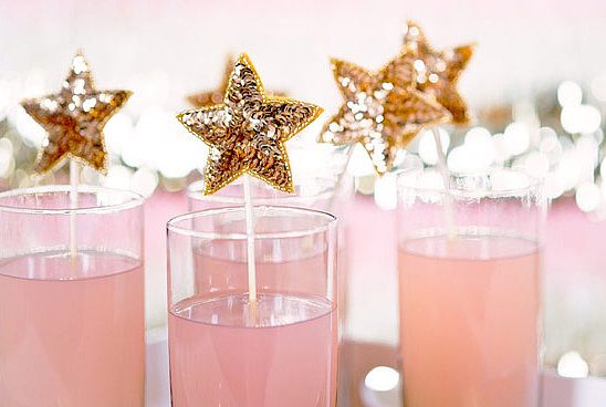 Use sequin star stirring sticks to add shine to your refreshments. Photo by Paper Antler via 100 Layer Cake