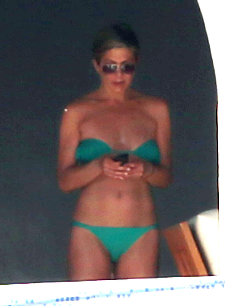 Jennifer Aniston greeted the day with a mint green bikini.