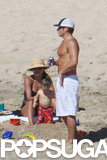 Nick showed off his shirtless body on the beach in Cabo.
