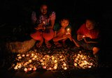 Kids lit candles and prayed to celebrate the start of 2014 in Surabaya, Indonesia.