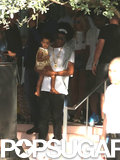 Jay Z carried Blue Ivy down the stairs while Beyoncé followed close behind.