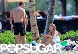 Gwyneth and Chris talked on the beach.
